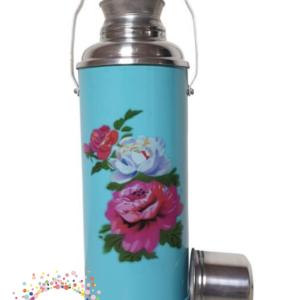 Blauwe fles met rozen